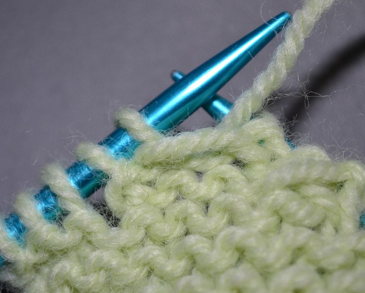 Close up of Wrap and Turn a Purl Stitch