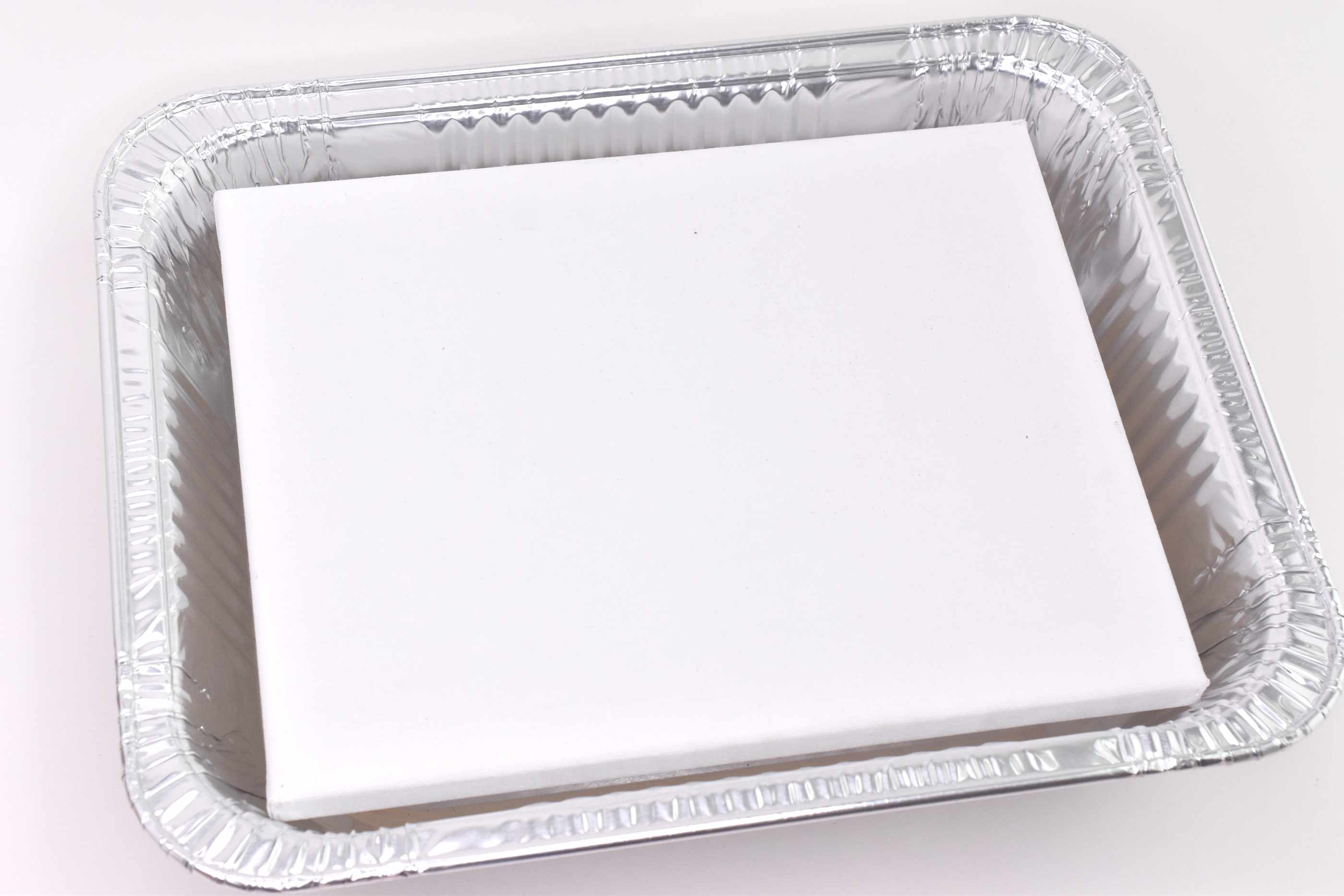 Blank canvas in a metal tray