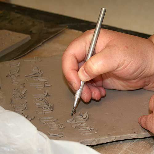 Carving a design into the Mishima technique.