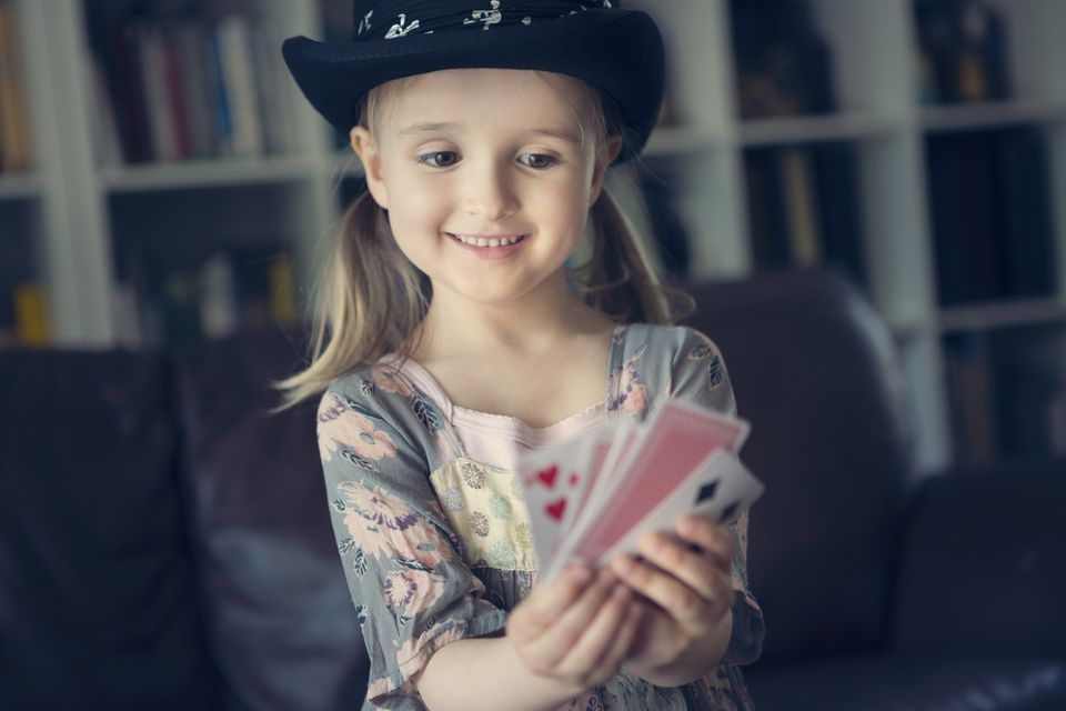 kid playing with magic cards