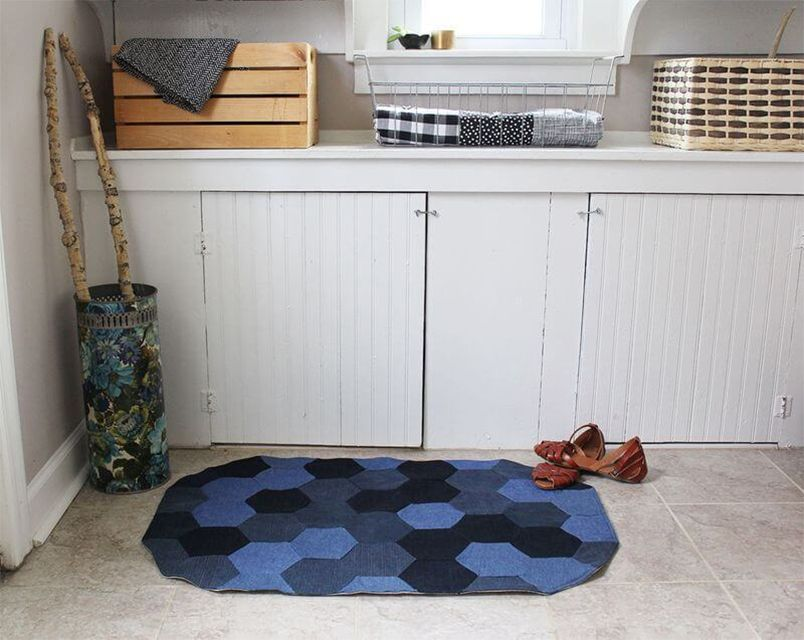 A denim rug with a pair of shoes