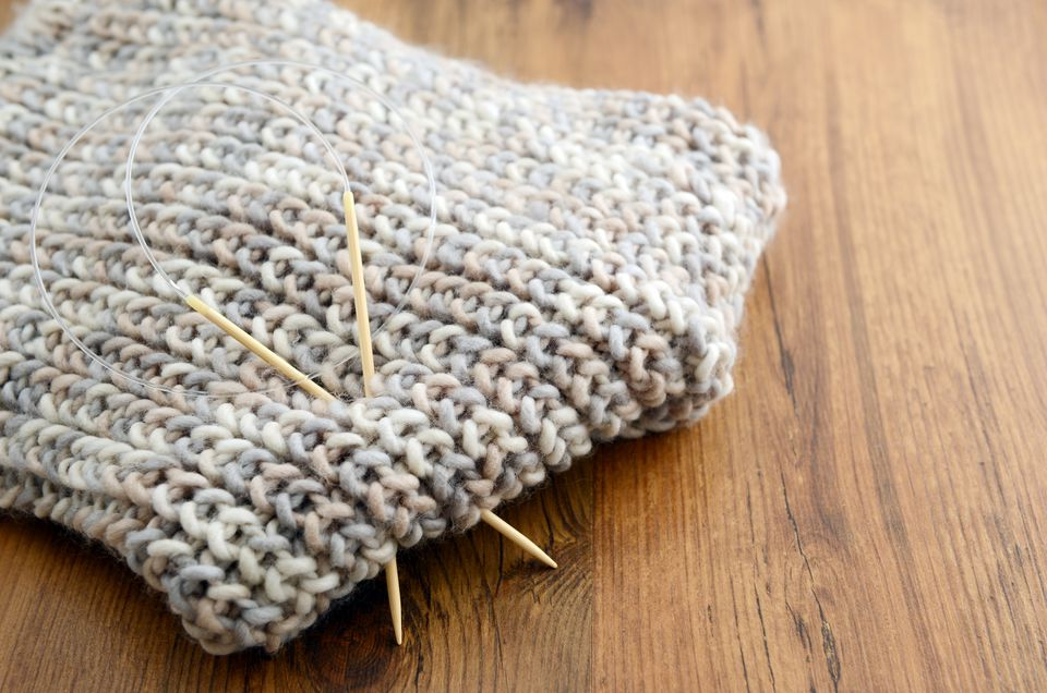 High Angle View Of Sewing Needle On Scarf At Table