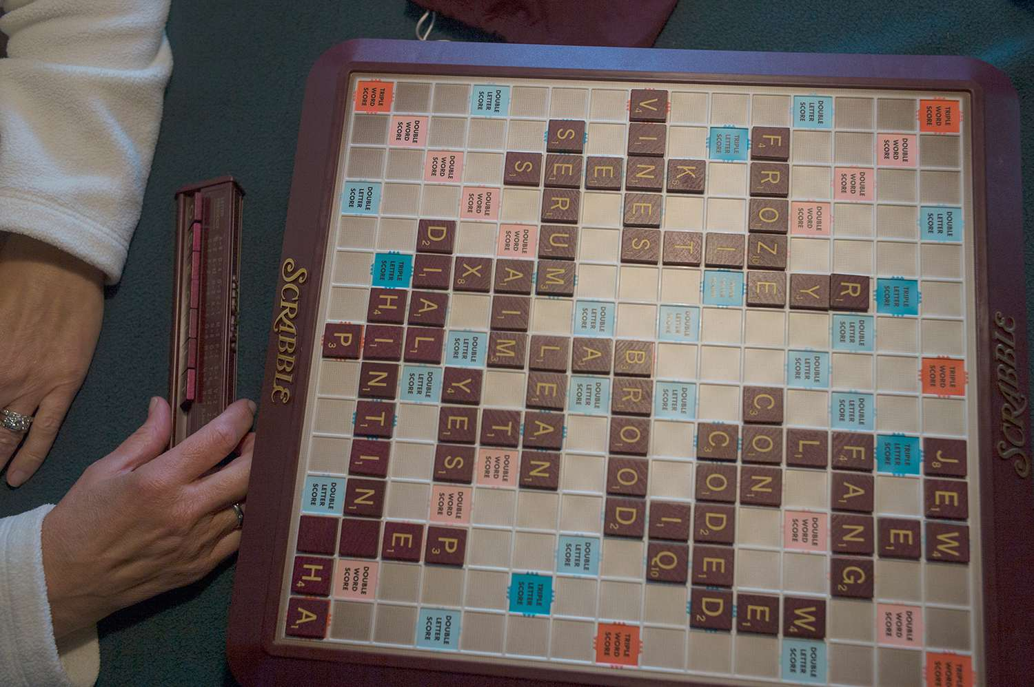 Scrabble board filled with numerous words.