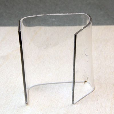 A twisted bend in sheet plastic created when uneven pressure was applied to plastic in a jig.