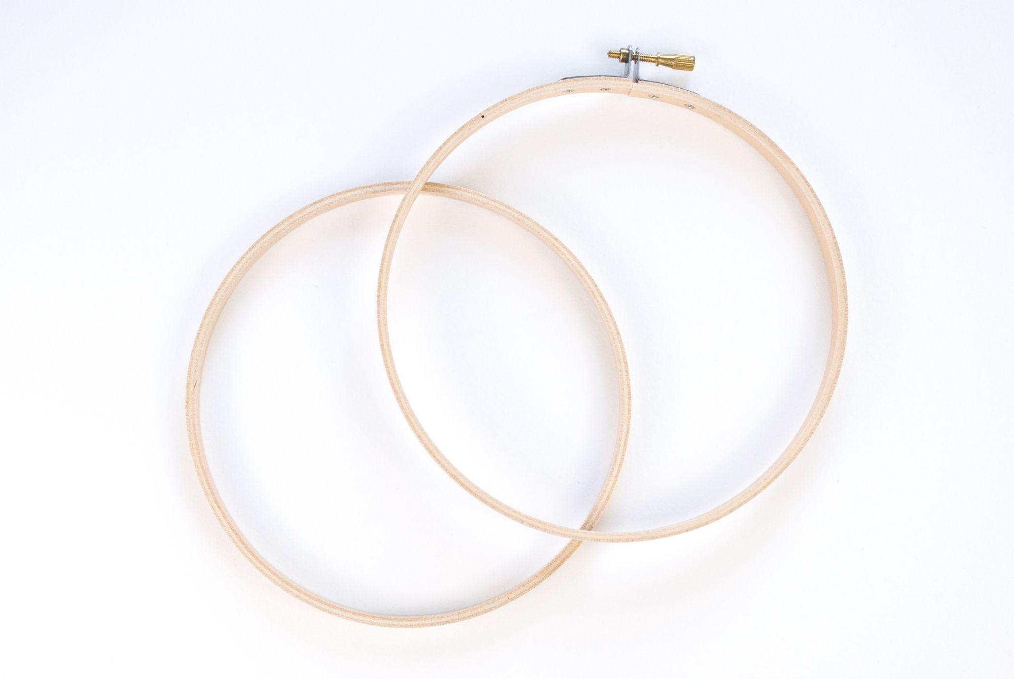 An embroidery hoop taken apart so there are two circles.