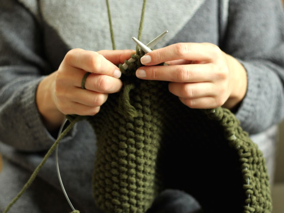 Woman knitting with two circular needles