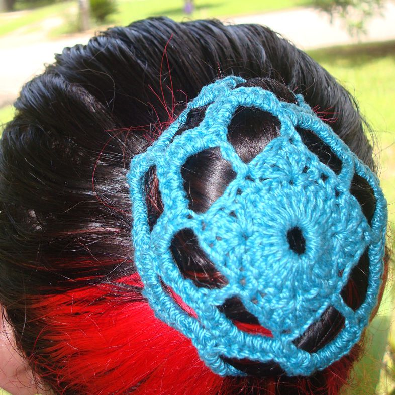 Woman wearing a bun cover with a square design