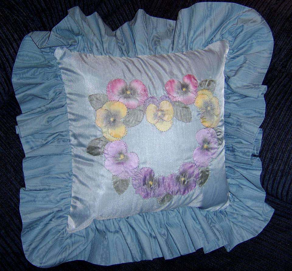 A shadow applique pillow with ruffles