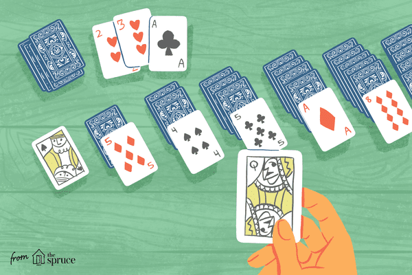A hand playing solitaire