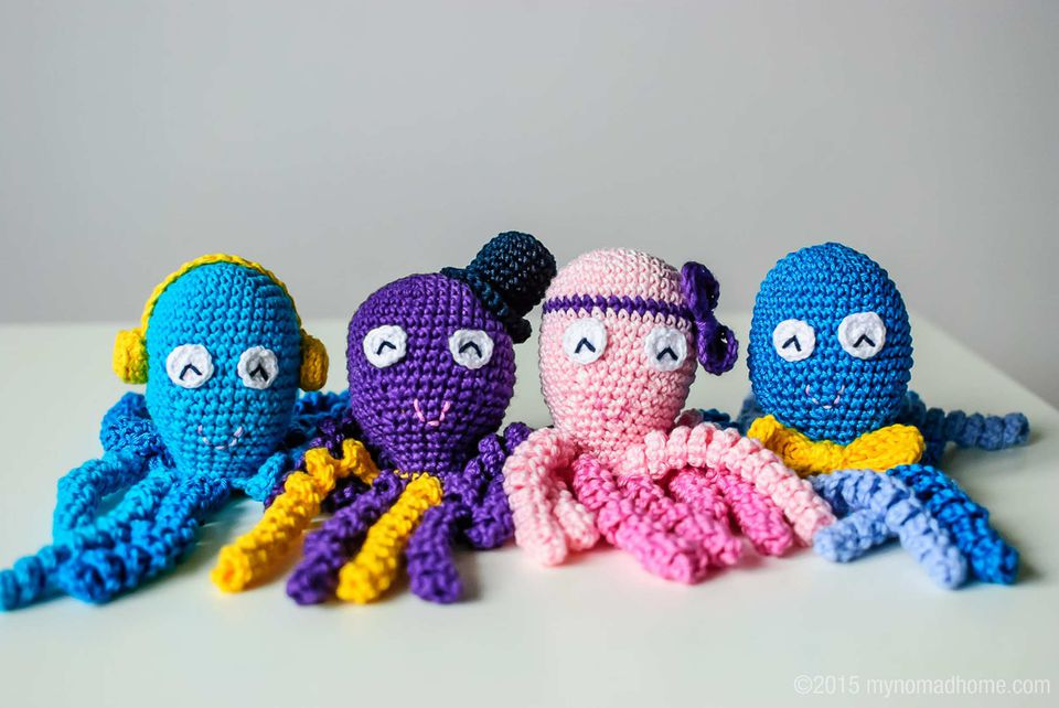 Colorful crochet octopuses with different hats and head accessories