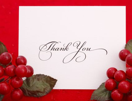 A Christmas thank you card with holly and berries