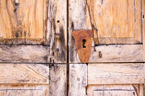 Santa Fe Style: Mesquite Wood Door with Rusty Keyhole (Detail)