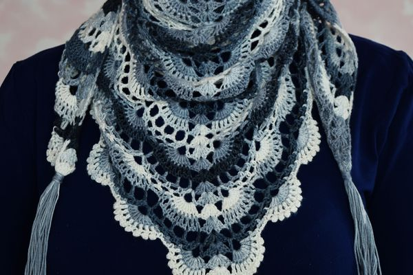 Woman in lace crochet. Woman with colorful shawl. Knitted white-blue handkerchief for girl.