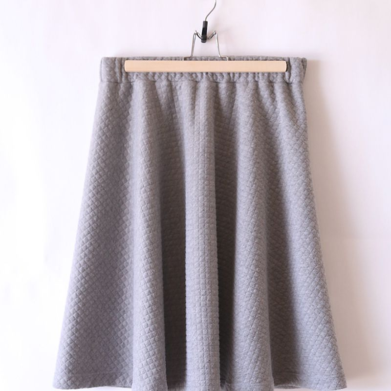 A gray skirt on a hanger