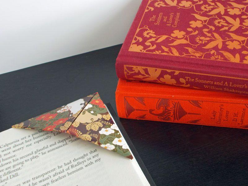 Origami bookmark next to books