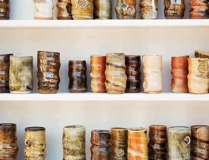 Handmade pottery on shelves