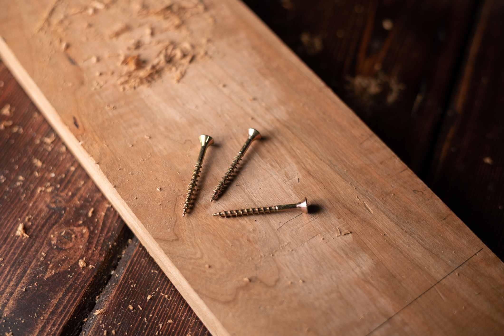 Screws on top of wood plank