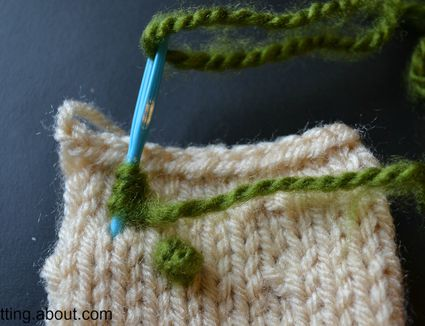 Adding a french knot with yarn to a knitting project