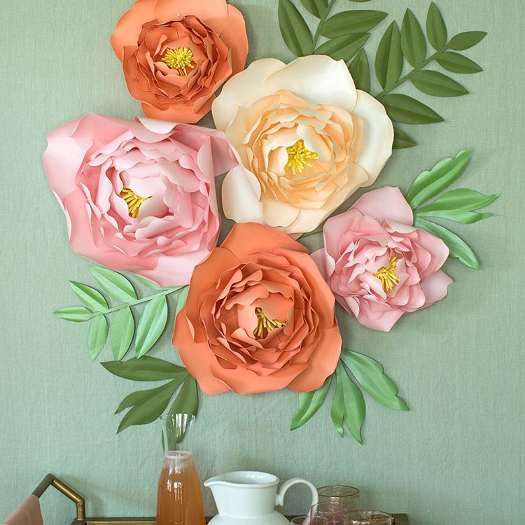 A wall with colorful jumbo paper peonies