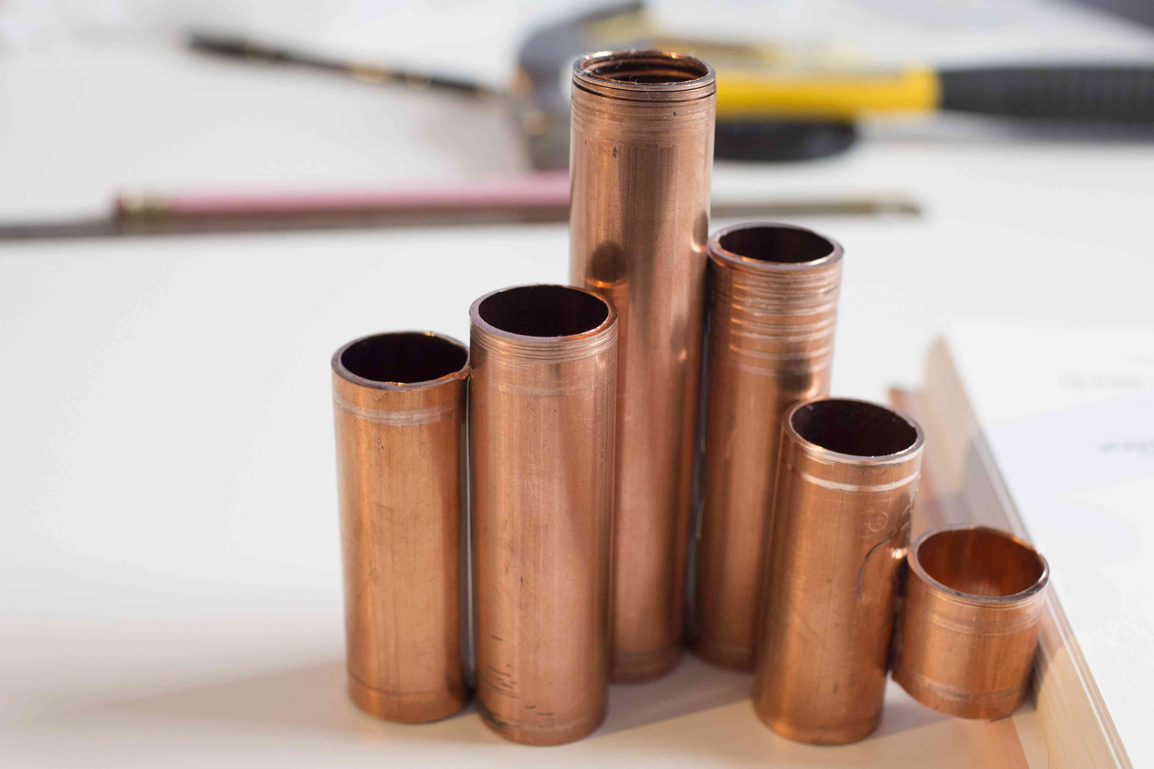 A finished candleholder made with copper pipe pieces and craft adhesive