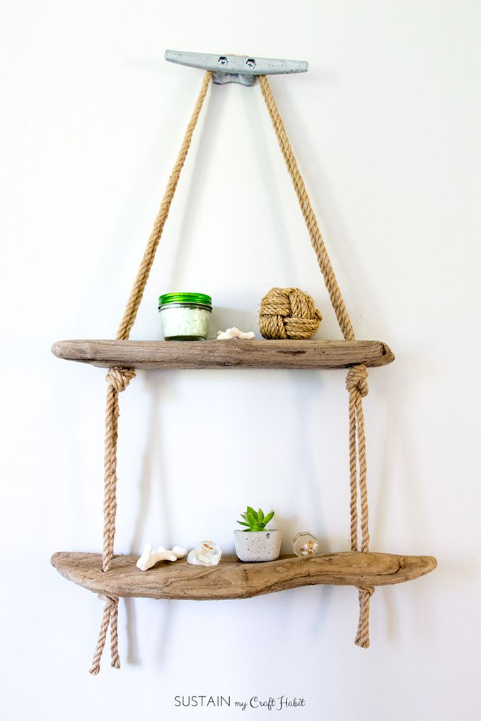 Hanging shelf with trinkets and hanging from a wall.