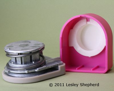 Assembly order for the parts of a plastic covered paper punch.