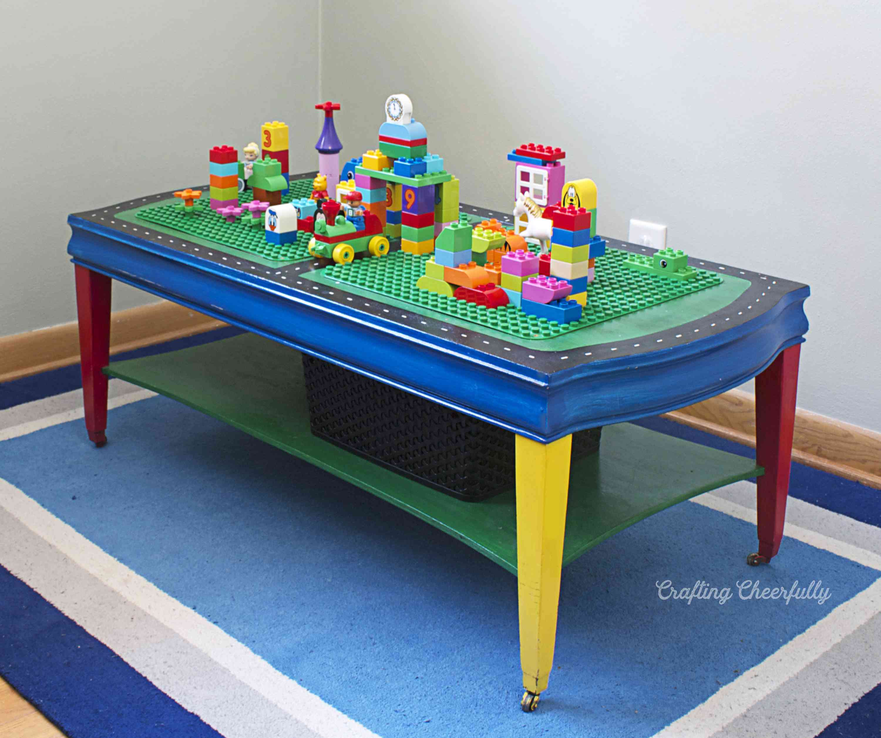 A lego table on a colorful rug