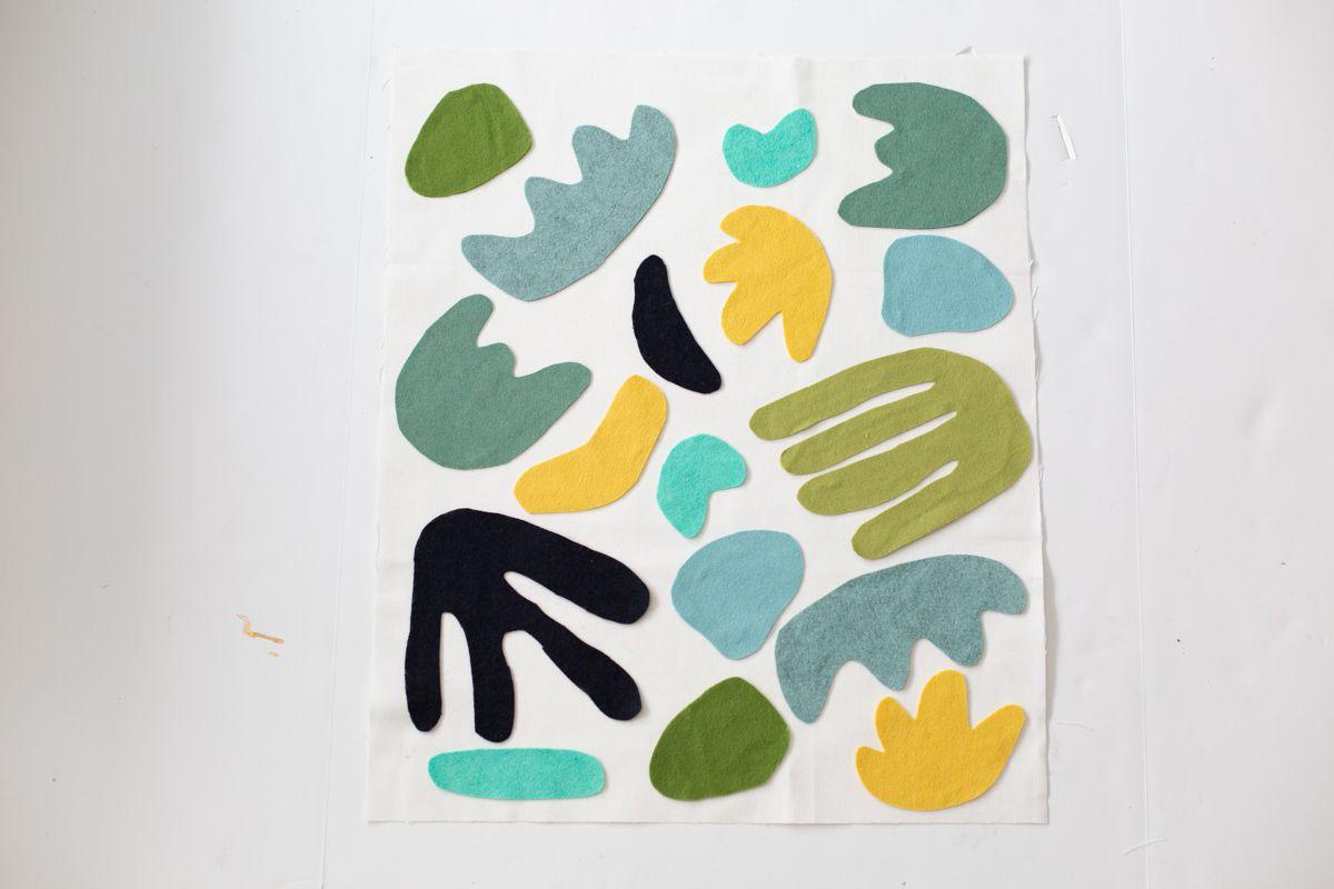 Felt shapes on DIY wall tapestry