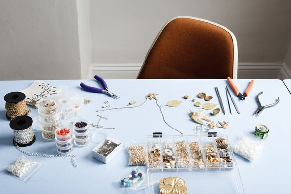 jewelry-making materials laid out on a table