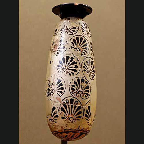 Ancient Greek pottery alabastron, a long vessel used to hold perfumed oils for use after bathing.