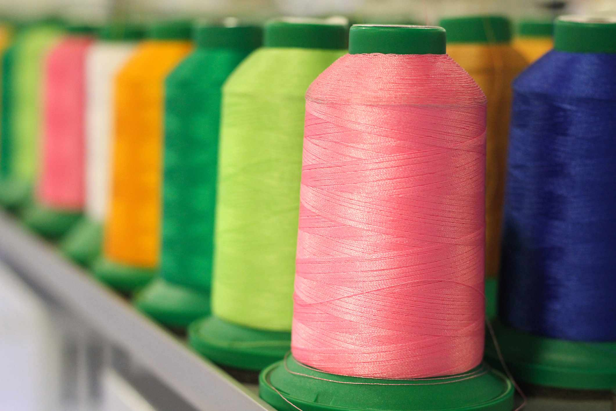 Rows of colorful thread spools