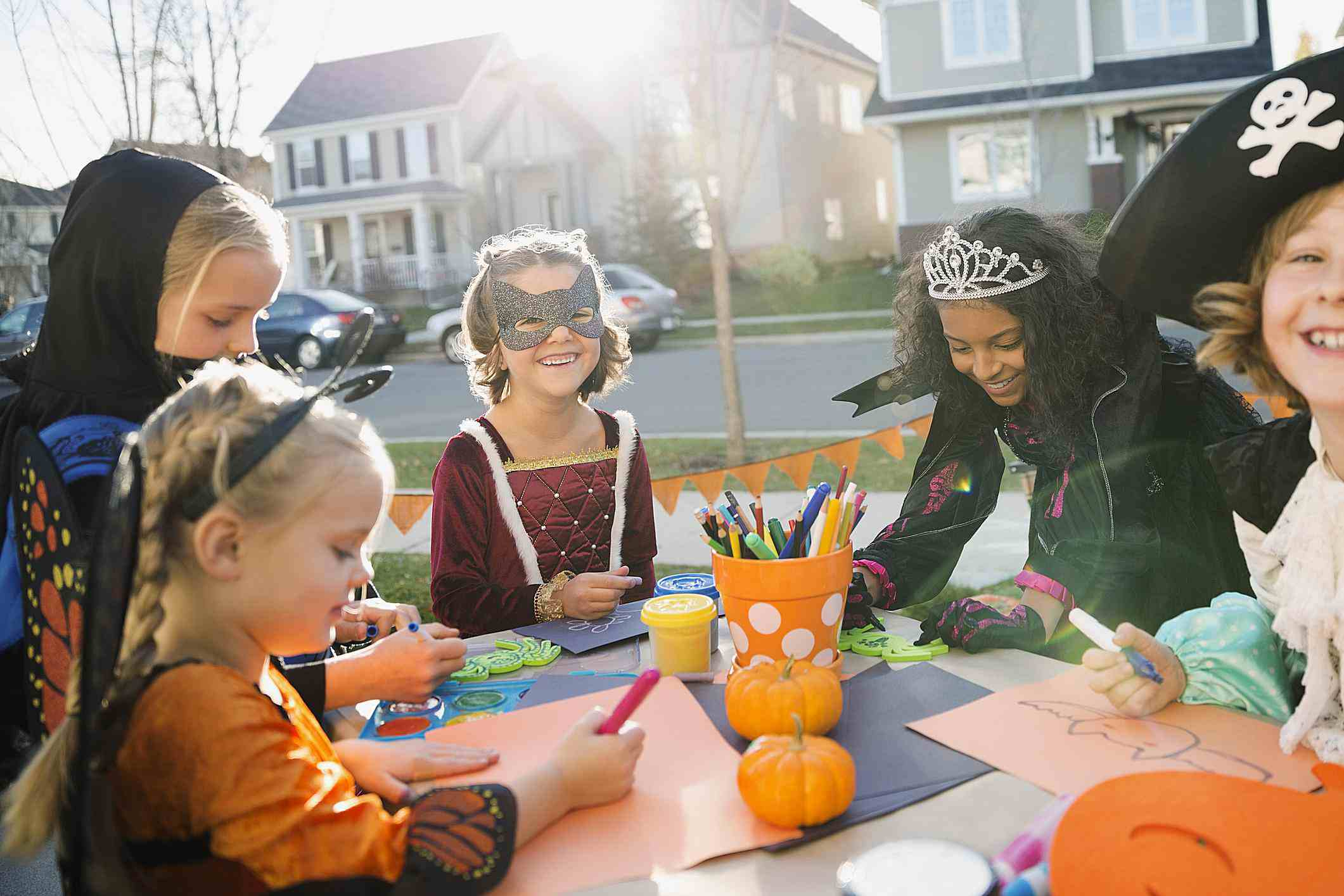 Kids doing Halloween crafts in costumes