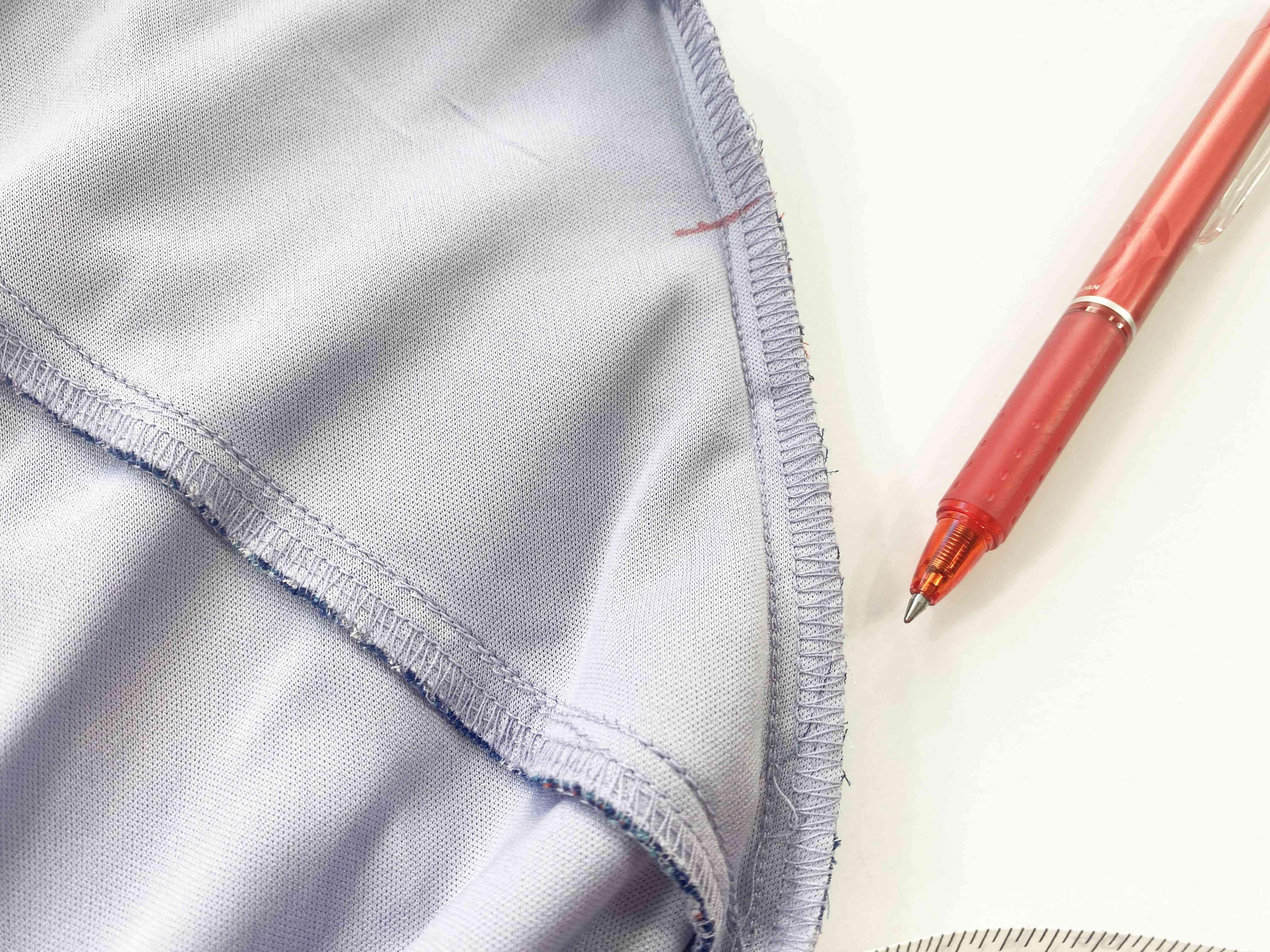 A dress and marking pen