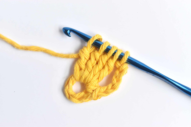 Work a 4 Treble Crochet Cluster