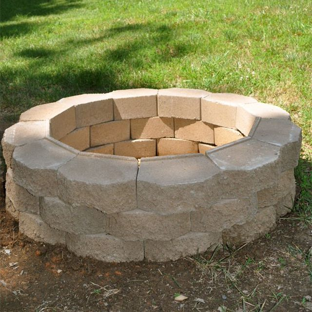 A cement fire pit in a yard