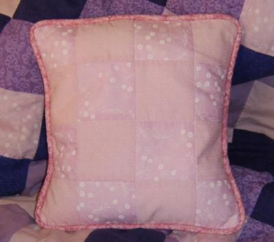 A finished pillow with piping.