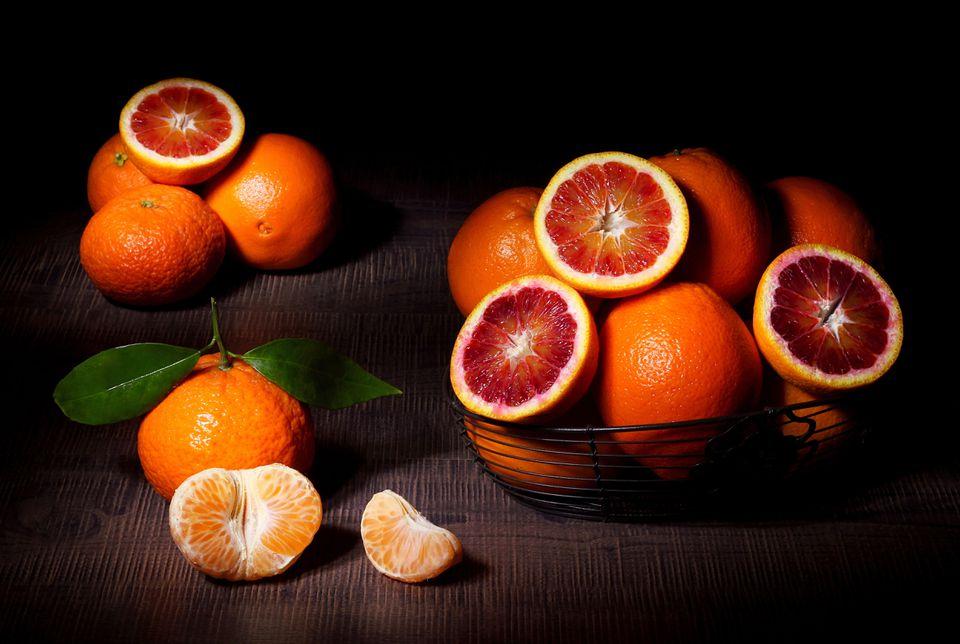 chiaroscuro painting of oranges