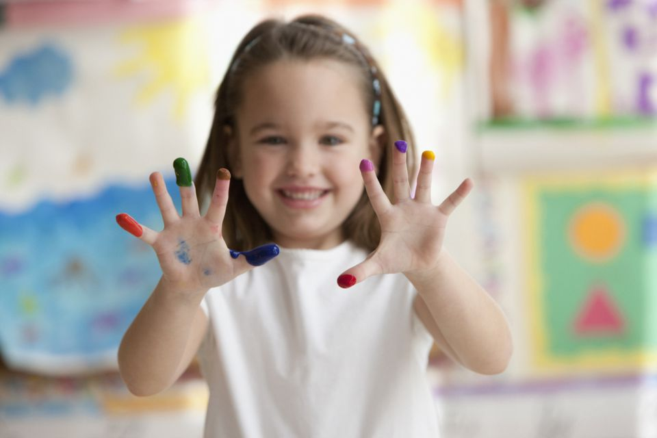 Caucasian girl showing painted fingers