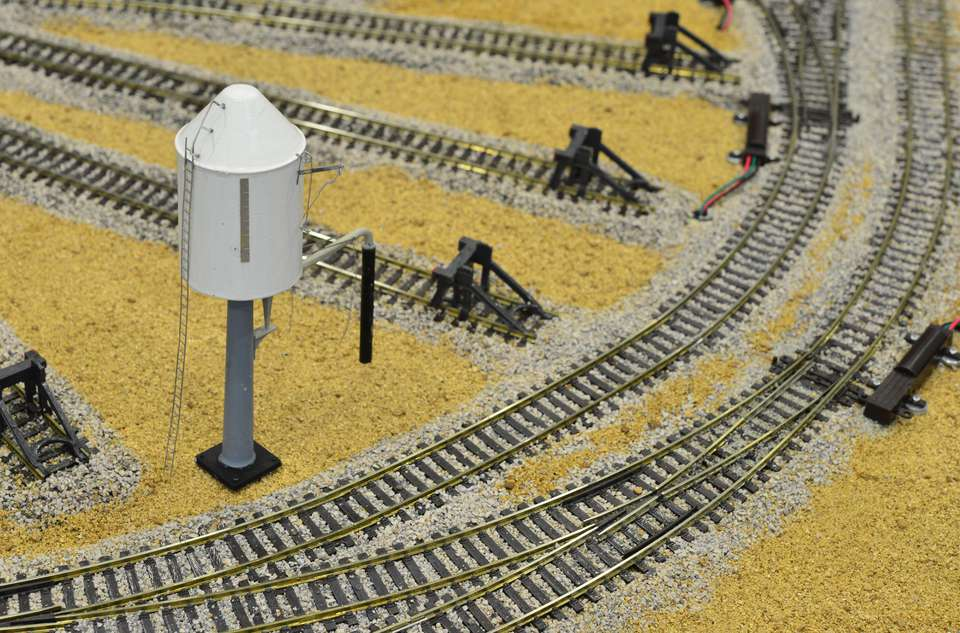 Model of a water tower on a model railway desert landscape