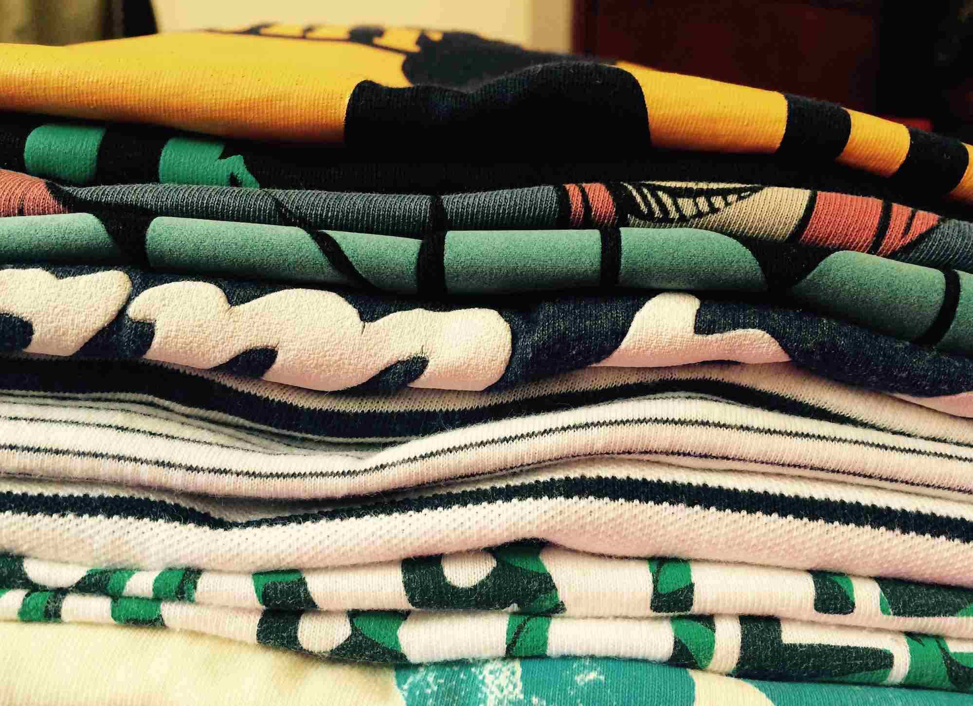 Close-Up Of Folded Clothes At Home