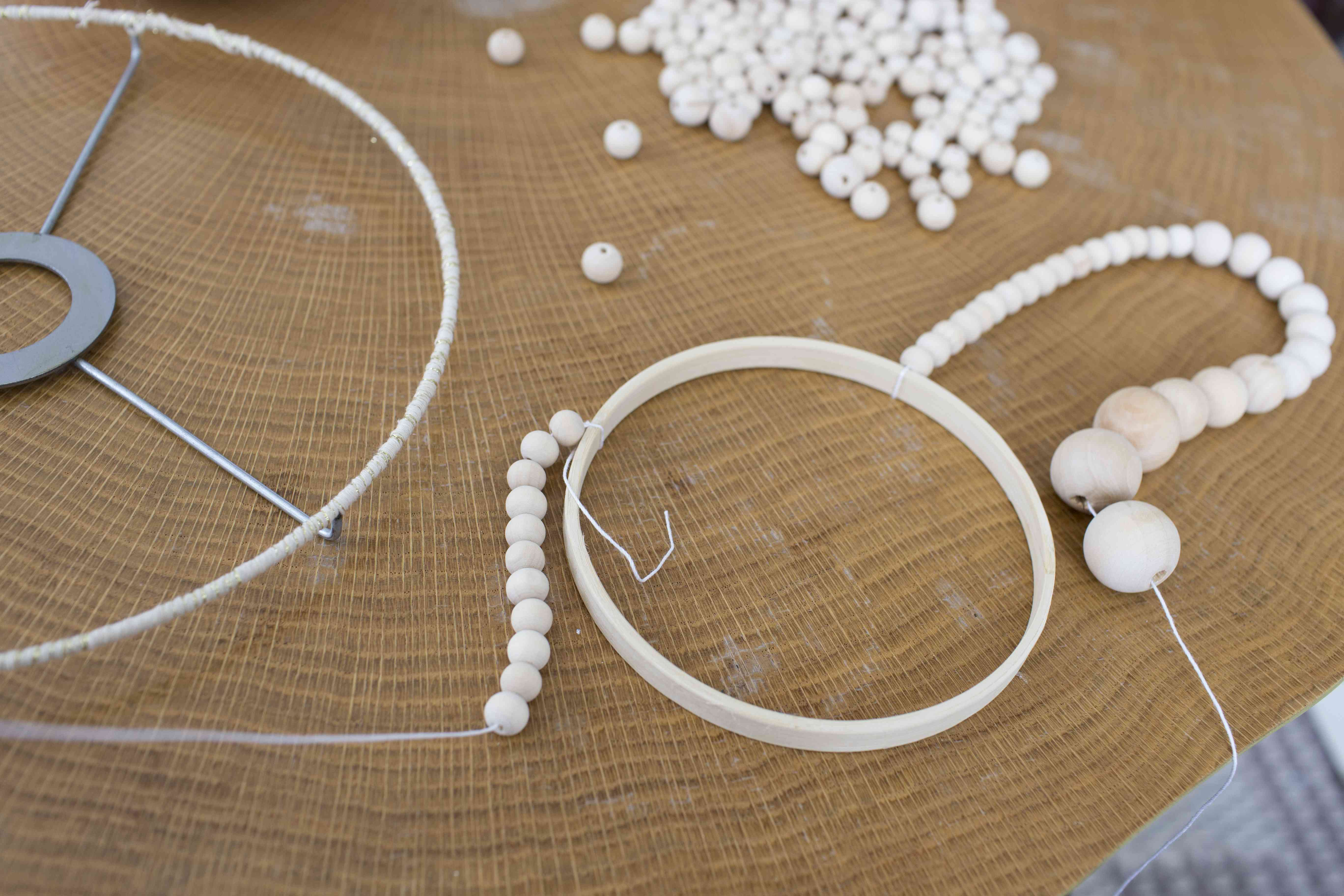 Stringing on the woodent beads.