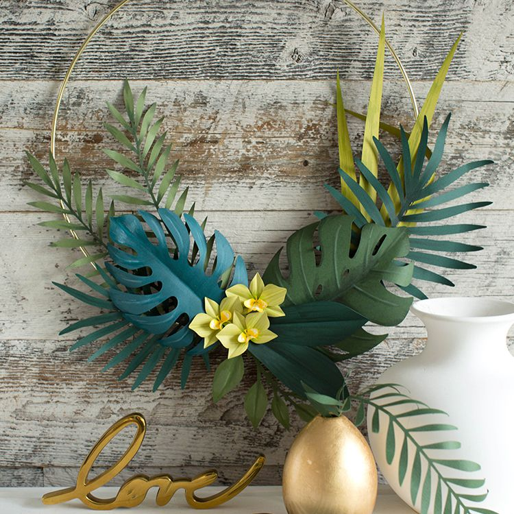 a summer wreath made with tropical paper leaves