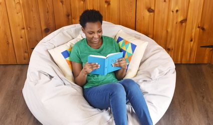 Young Woman Reading in a DIY Beanbag Chair
