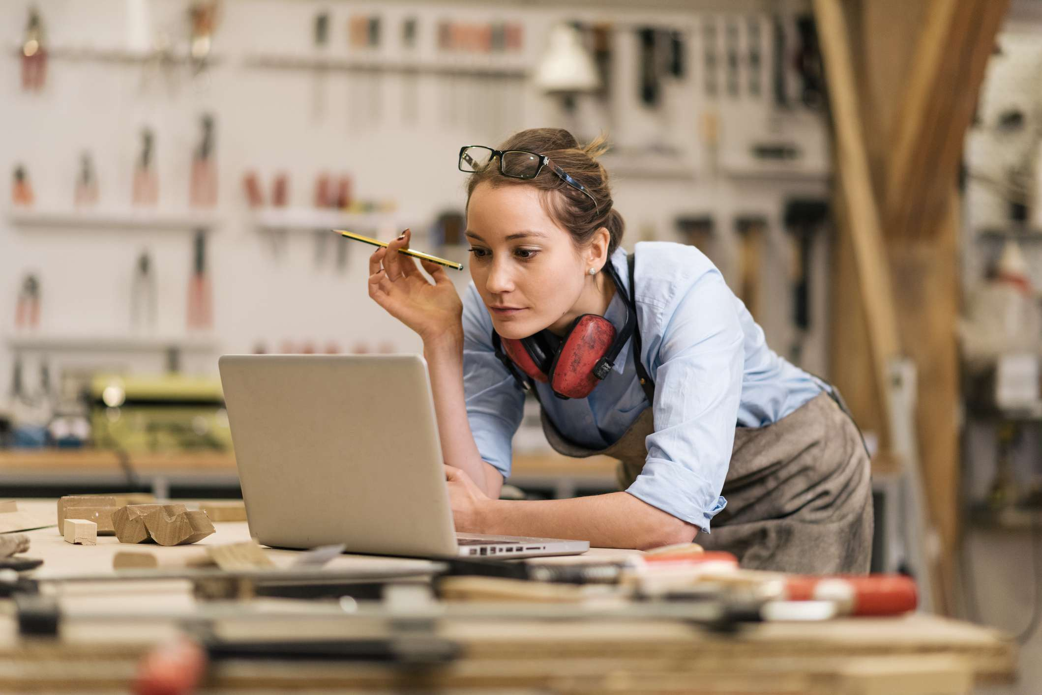 Woman wearing proper clothing in woodworking shop