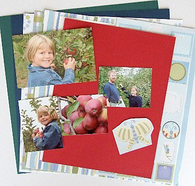 family photos on top of sample scrapbook pages