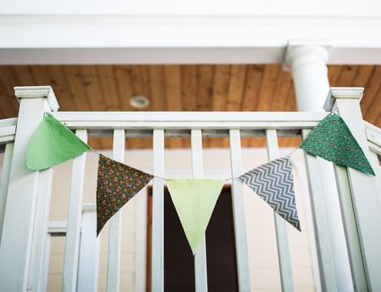 Hand made pennant banner hanging from a bannaster handrail