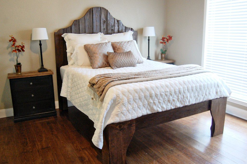 A curved wooden headboard