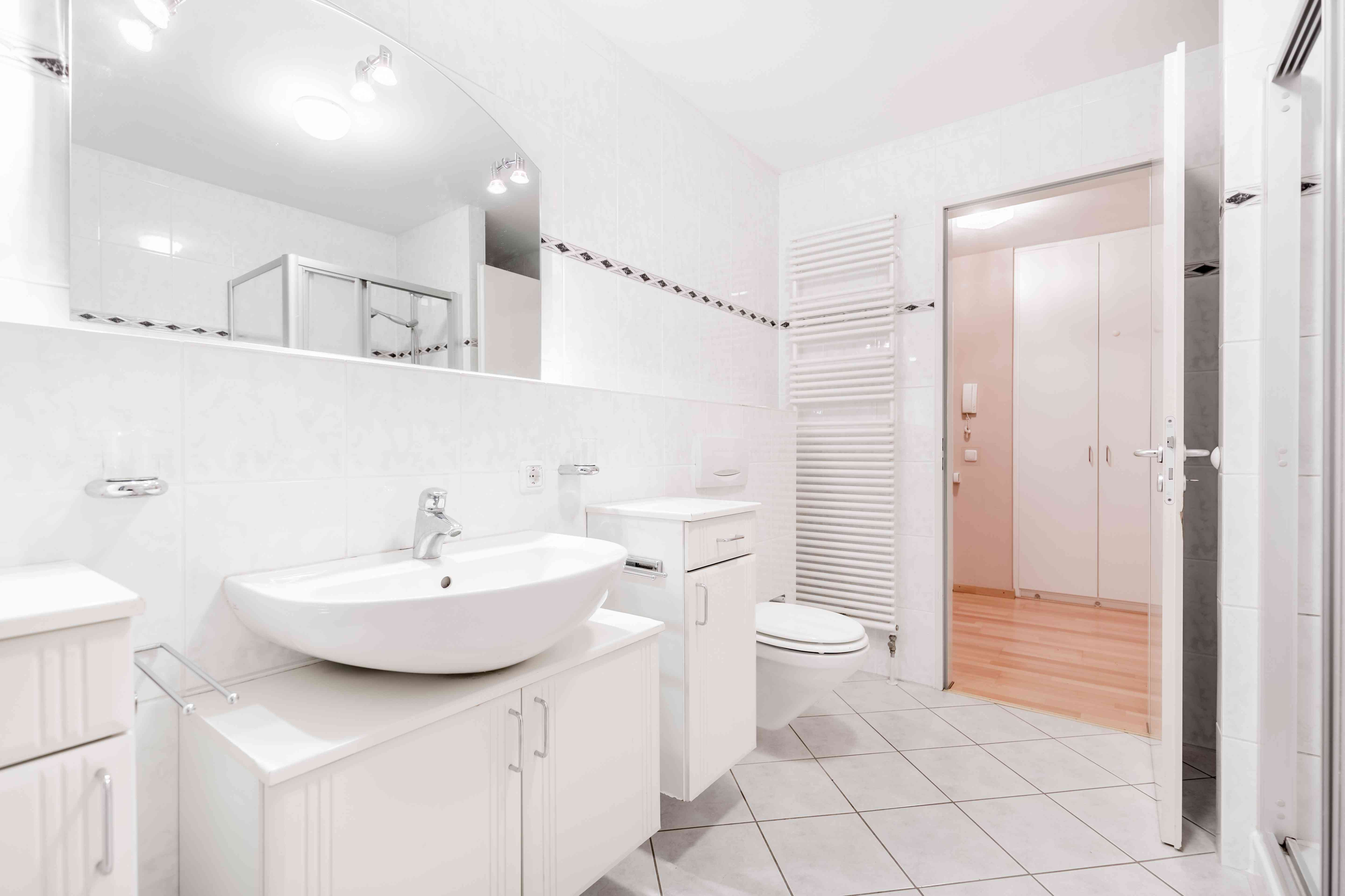 A bathroom oufitted with many cabinets