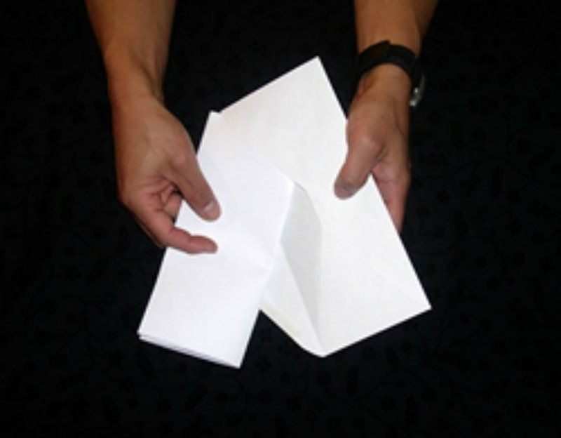 Putting paper in envelope