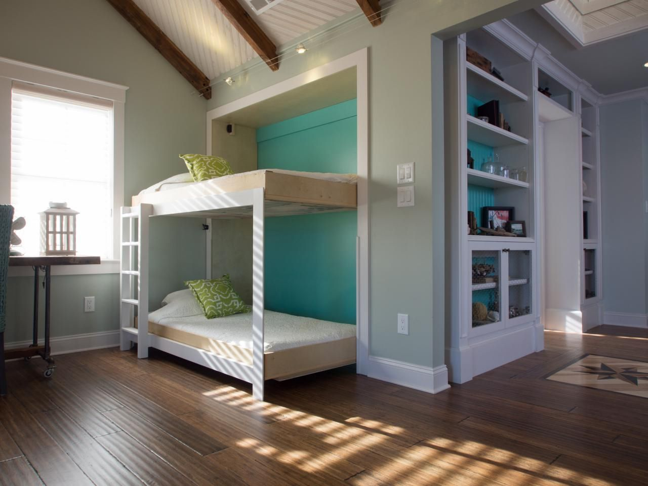 A large room with twin Murphy beds
